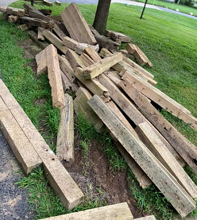 pile of wood from fence construction debris removal job in rialto ca